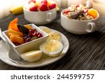 fresh fruit and oatmeal with... | Shutterstock . vector #244599757