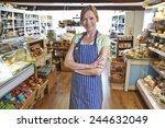 owner of delicatessen standing... | Shutterstock . vector #244632049