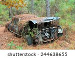 An Old Rusted Out Scrap Car...