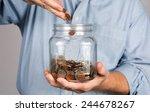 Man Drops Money Into A Glass...
