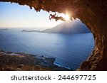 male rock climber flexing his... | Shutterstock . vector #244697725