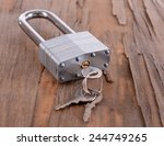 padlock with keys on wooden... | Shutterstock . vector #244749265