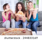 young woman eating pizza at home | Shutterstock . vector #244833169