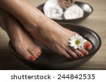 female feet with drops of water ... | Shutterstock . vector #244842535