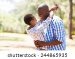 cheerful young african couple... | Shutterstock . vector #244865935
