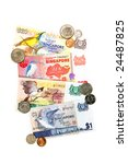 A collection of coins and currency from the country of Singapore - stock photo