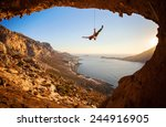 rock climber hanging on rope... | Shutterstock . vector #244916905