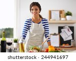 smiling young woman  mixing... | Shutterstock . vector #244941697