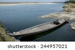 Small photo of INDIA, ASSAM, MANAS NATIONAL PARK - NOVEMBER, 2014: Traditional wooden Indian boat on the Beki river in Manas