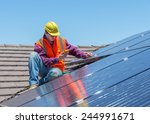 young worker checking solar... | Shutterstock . vector #244991671