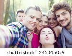 young people having good time... | Shutterstock . vector #245045059