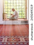 a man in a mosque near the... | Shutterstock . vector #245049319