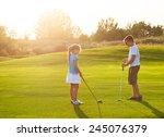 casual kids at a golf field... | Shutterstock . vector #245076379