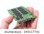 Small photo of Opened solid state drive closeup on white background