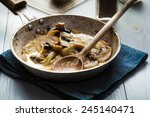 Sliced Mushrooms With Onion On...