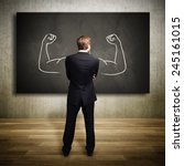 strong businessman standing in... | Shutterstock . vector #245161015