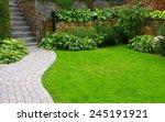 Garden Stone Path With Grass...