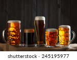 beer glasses with lager  dark... | Shutterstock . vector #245195977