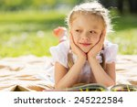 little cute girl in summer park ... | Shutterstock . vector #245222584