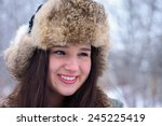 happy winter time. young girl ... | Shutterstock . vector #245225419