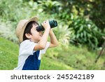 little asian boy looking trough ... | Shutterstock . vector #245242189