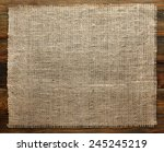 burlap texture on wood | Shutterstock . vector #245245219