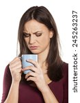 scowling young woman is... | Shutterstock . vector #245263237