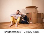 young couple with boxes dream