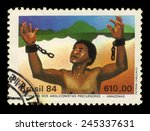 Small photo of Brazil - CIRCA 1984: a stamp printed in Brazil shows slave tearing the chain, abolition of slavery in countries of Amazon, circa 1984