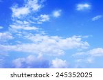 blue sky background with tiny... | Shutterstock . vector #245352025