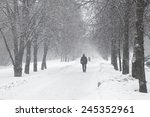 alley in a town during a snow... | Shutterstock . vector #245352961