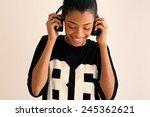 happy brazilian girl portrait... | Shutterstock . vector #245362621