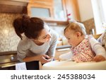 young mother and her little... | Shutterstock . vector #245388034