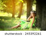 young girl with flowers in the... | Shutterstock . vector #245392261