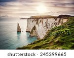Small photo of Old Harry Rocks, located at Handfast Point, on the Isle of Purbeck in Dorset, southern England, United Kingdom; the downlands of Ballard Down were formed approximately 66 million years ago