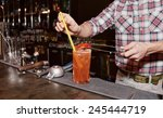 bartender is decorating... | Shutterstock . vector #245444719