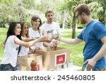 Volunteer Group Receives Food...