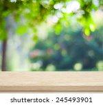 empty wooden deck table over... | Shutterstock . vector #245493901