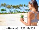 woman drinking vegetable green... | Shutterstock . vector #245509441