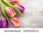 Tulips On A Wooden Surface....