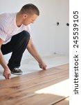 installing laminate flooring in ...   Shutterstock . vector #245539105