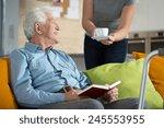 elderly happy man reading the... | Shutterstock . vector #245553955