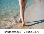 legs of a young woman walking... | Shutterstock . vector #245562571