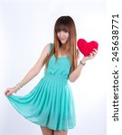 asian woman holding a red heart ... | Shutterstock . vector #245638771