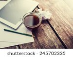 digital tablet and cup of... | Shutterstock . vector #245702335