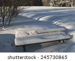 Snow Covered Bench In Winter...