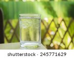 glass of water on wood table | Shutterstock . vector #245771629
