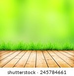 wooden table with grass and... | Shutterstock . vector #245784661