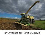 Постер, плакат: corn harvester in the