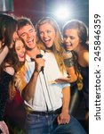 happy friends singing karaoke... | Shutterstock . vector #245846359